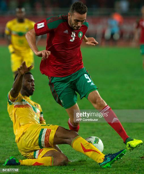 Morocco's Mahi Mimoun vies for the ball with Mali's Molla Wague during the World Cup 2018 Africa qualifying football match between Morocco and Mali...