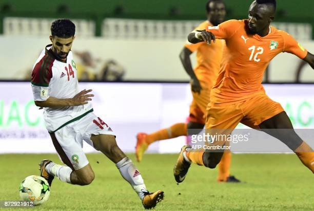 Morocco's Mbark Boussoufa vies with Ivory Coast's Mohamed Fofana during the FIFA World Cup 2018 Africa Group C qualifying football match between...