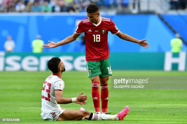 Morocco's midfielder Amine Harit and Iran's defender Ramin Rezaian react during the Russia 2018 World Cup Group B football match between Morocco and...