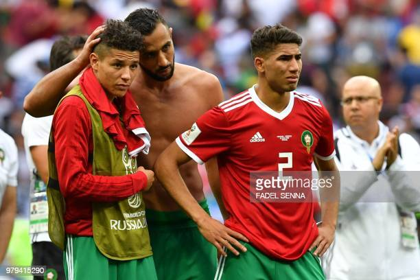Morocco's midfielder Amine Harit Morocco's defender Mehdi Benatia and Morocco's defender Achraf Hakimi react at the end of the Russia 2018 World Cup...