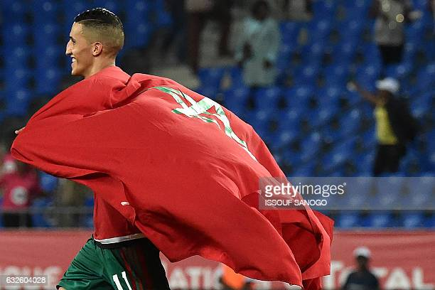 Morocco's midfielder Faycal Fajr celebrates at the end of the 2017 Africa Cup of Nations group C football match between Morocco and Ivory Coast in...