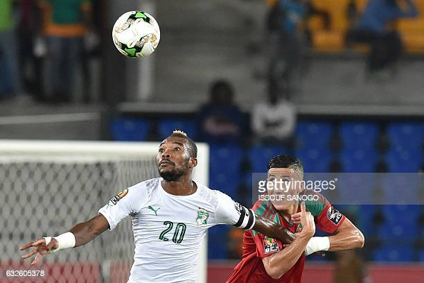 TOPSHOT Morocco's midfielder Faycal Fajr challenges Ivory Coast's midfielder Serey Die during the 2017 Africa Cup of Nations group C football match...