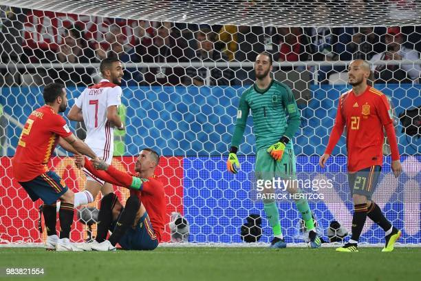 Morocco's midfielder Hakim Ziyech celebrates past Spain's defender Dani Carvajal Spain's defender Sergio Ramos Spain's goalkeeper David De Gea and...