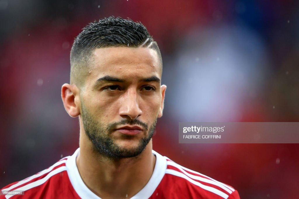 Morocco's midfielder Hakim Ziyech looks on prior to the friendly football match between Morocco and Ukraine at the Stade de Geneve stadium in Geneva on May 31, 2018.