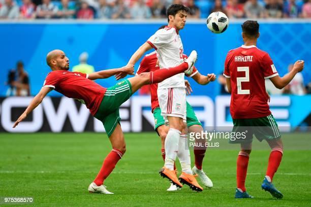 Morocco's midfielder Karim El Ahmadi and Iran's forward Sardar Azmoun vie during the Russia 2018 World Cup Group B football match between Morocco and...