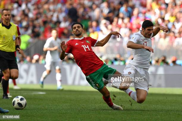 Morocco's midfielder Mbarek Boussoufa and Portugal's forward Goncalo Guedes react as they fall during the Russia 2018 World Cup Group B football...