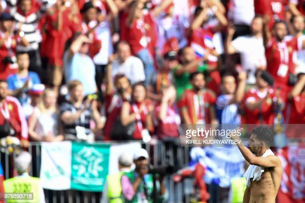Morocco's midfielder Mbarek Boussoufa greets the public at the end of the Russia 2018 World Cup Group B football match between Portugal and Morocco...