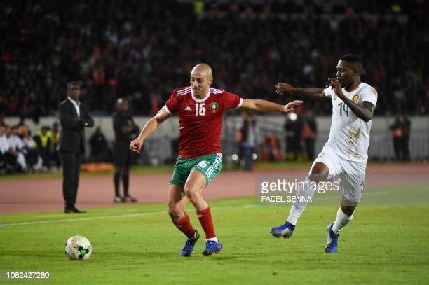 Morocco's midfielder Nordin Amrabat is marked by Cameroon's midfielder Georges Mandjeck during the Africa Cup of Nations qualifier football match...