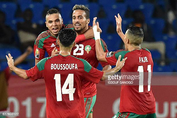 Morocco's midfielder Rachid Alioui celebrates with teammates after scoring a goal during the 2017 Africa Cup of Nations group C football match...