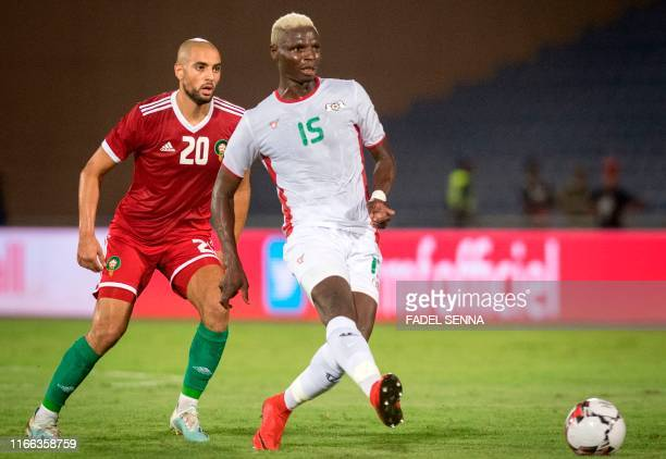 Morocco's midfielder Sofyan Amrabat vies for the ball with Burkina Faso's forward Aristide Bance during the friendly football match between Morocco...