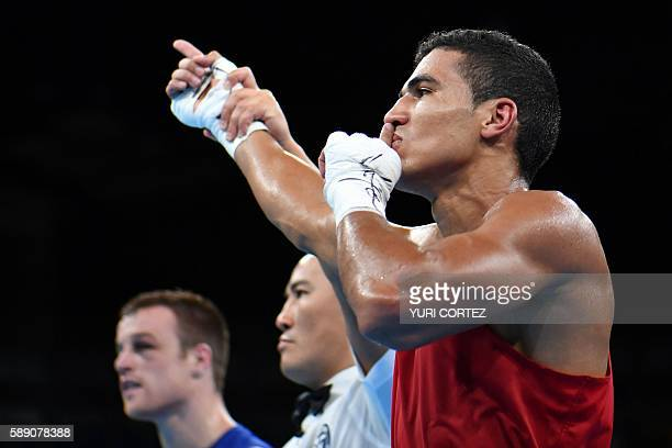 Morocco's Mohammed Rabii celebrates winning against Ireland's Steven Gerard Donnelly during the Men's Welter Quarterfinal 1 at the Rio 2016 Olympic...