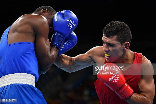 Morocco's Mohammed Rabii fights Kenya's Rayton Nduku Okwiri during the Men's Welter match at the Rio 2016 Olympic Games at the Riocentro Pavilion 6...