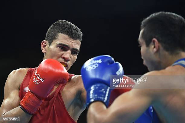 Morocco's Mohammed Rabii fights Uzbekistan's Shakhram Giyasov during the Men's Welter Semifinal 1 match at the Rio 2016 Olympic Games at the...