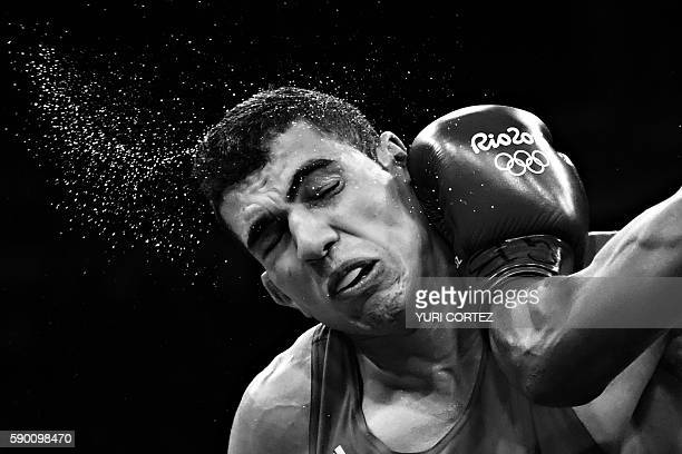 Morocco's Mohammed Rabii is punched by Kenya's Rayton Nduku Okwiri during the Men's Welter match at the Rio 2016 Olympic Games at the Riocentro...