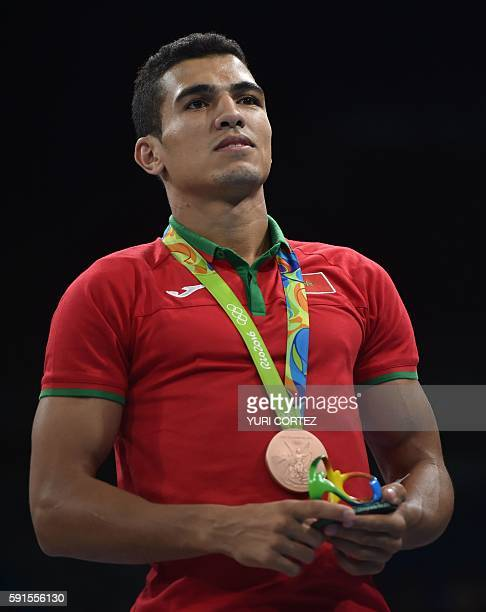 Morocco's Mohammed Rabii poses on the podium with a bronze medal after the Men's Welter Final Bout match at the Rio 2016 Olympic Games in Rio de...