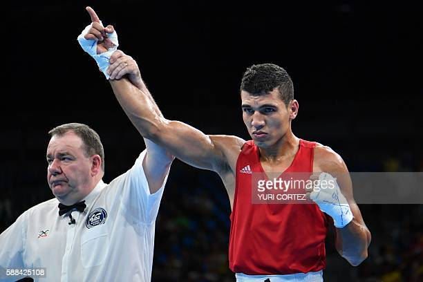 Morocco's Mohammed Rabii reacts after being announced the winner against Kenya's Rayton Nduku Okwiri during the Men's Welter match at the Rio 2016...