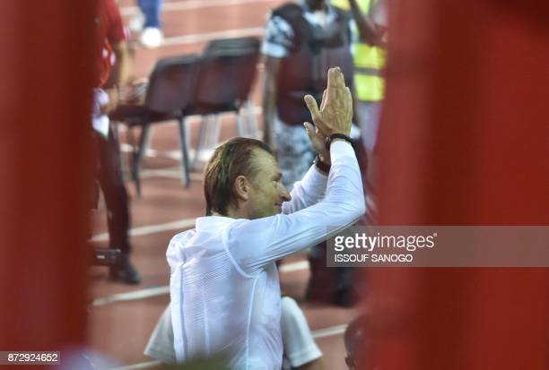 Morocco's National Football team French coach Herve Renard applauds at the Felix HouphouetBoigny stadium in Abidjan on November 11 at the end of the...