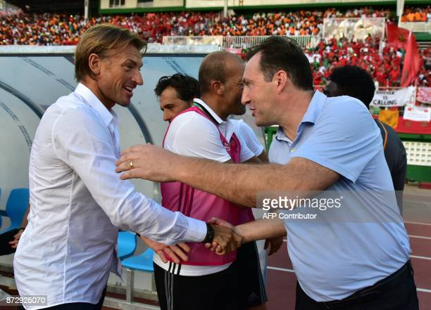 Morocco's National Football team French head coach Herve Renard shakes hands with Ivory Coast's Belgian coach Marc Wilmots at the Felix...