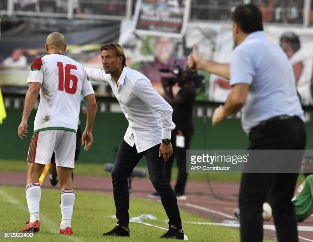 Morocco's National Football team French head coach Herve Renard speaks to player Noureddine Amrabat during the FIFA World Cup 2018 Africa Group C...