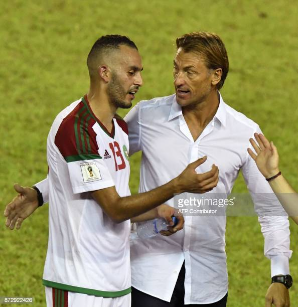 Morocco's National Football team French head coach Herve Renard speaks to player Khalid Boutaib during the FIFA World Cup 2018 Africa Group C...