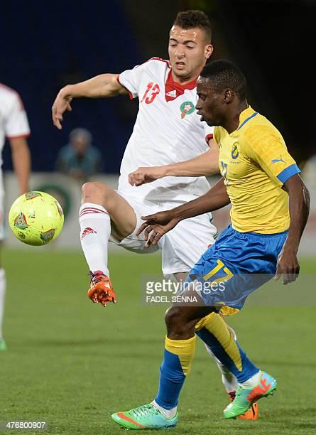 Morocco's national football team player El Kadouri Omar vies with Gabon's Andre Biyogho Poko during an international friendly match against Morocco...