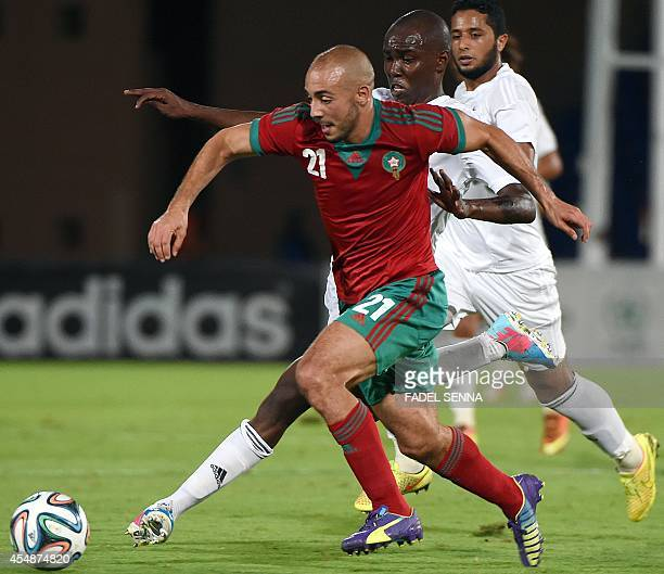 Morocco's Nordin Amrabat challenges Libya's AlMutasem Mohammed during a friendly football match between Morocco and Libya in Marrakesh on September 7...