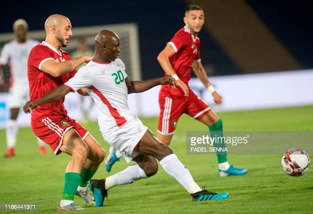 Morocco's Nordin Amrabat vies with the Burkina Faso's Yacouba Coulibaly during the friendly football match between Morocco and Burkina Faso in...