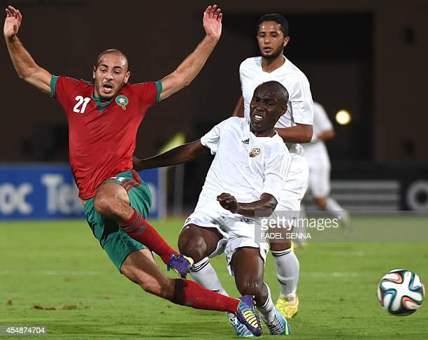 Morocco's Nordin Amrabet challenges Libya's AlMutasem Mohammed during a friendly football match between Morocco and Libya in Marrakesh on September 7...