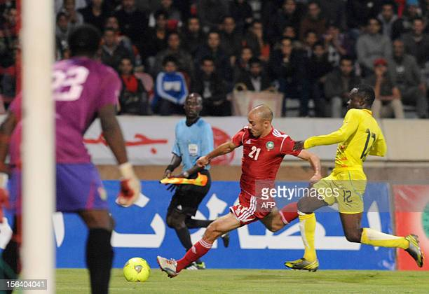 Morocco's Nordin Amrabet vies with Togo's Dokam Djene during the freindly match Morocco vs Togo in Casablanca on November 14 2012 AFP / PHOTO /FADEL...