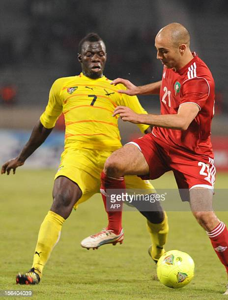 Morocco's Nordin Amrabet vies with Togo's Moustapha Salifou during the freindly match Morocco vs Togo in Casablanca on november 14 2012 AFP / PHOTO...
