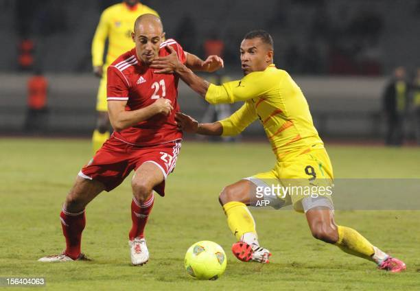 Morocco's Nordin Amrabet vies with Togo's Thomas Dossevi during the freindly match Morocco vs Togo in Casablanca on November 14 2012 AFP / PHOTO...