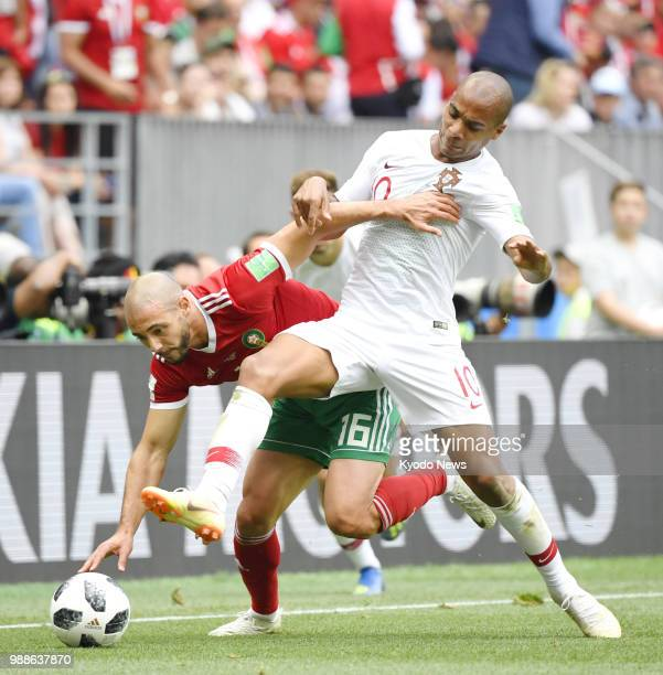 Morocco's Noureddine Amrabat and Portugal's Joao Mario fight for the ball during a World Cup Group B match at Luzhniki Stadium in Moscow on June 20...