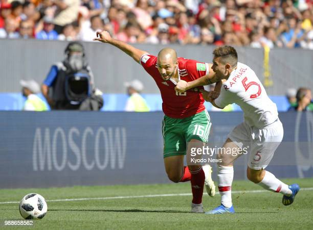 Morocco's Noureddine Amrabat competes for the ball against Portugal's Raphael Guerreiro during a World Cup Group B match at Luzhniki Stadium in...