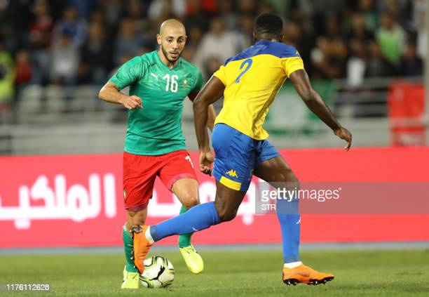 Morocco's Noureddine Amrabat vies for the ball with Gabon's Dndele Appindangoye Aaron during the friendly football match between Morocco and Gabon in...