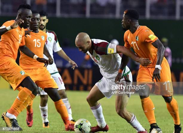 Morocco's Noureddine Amrabat vies with Ivory Coast's Serge Aurier Max Gradel and Mohamed Fofana during the FIFA World Cup 2018 Africa Group C...