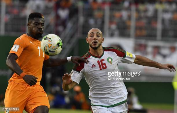 Morocco's Noureddine Amrabat vies with Ivory Coast's Serge Aurier during the FIFA World Cup 2018 Africa Group C qualifying football match between...