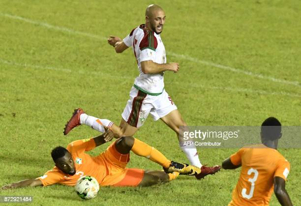 Morocco's Noureddine Amrabat vies with Ivory Coast's Serge Konan and Ghislain Konan during the FIFA World Cup 2018 Africa Group C qualifying football...