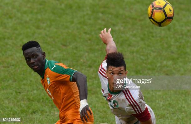 Morocco's player Achraf Dari vies Ivory Coast's Arnaud Ake Loba during the 8th Francophonie Games final football match between Ivory Coast and...