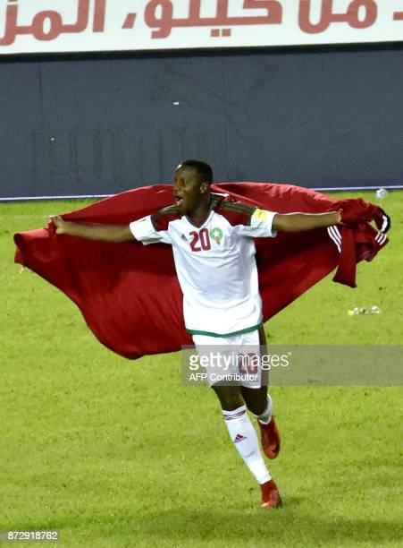 Morocco's player Hamza Mendyl celebrates at the Felix HouphouetBoigny stadium in Abidjan on November 11 after the FIFA World Cup 2018 Africa Group C...