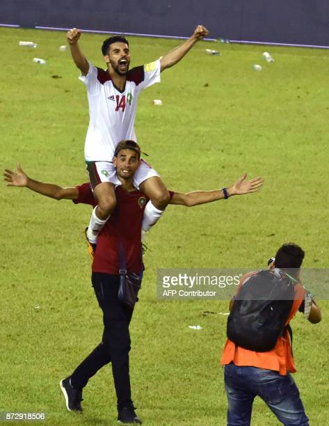 Morocco's player Mbark Boussoufa celebrates a goal at the Felix HouphouetBoigny stadium in Abidjan on November 11 during the FIFA World Cup 2018...
