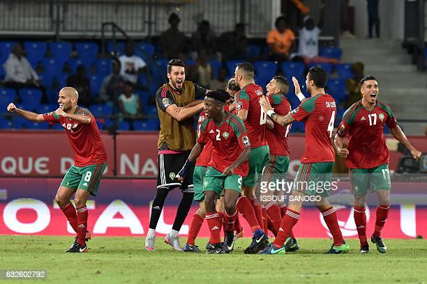 Morocco's players celebrate after scoring a goal during the 2017 Africa Cup of Nations group C football match between Morocco and Ivory Coast in Oyem...