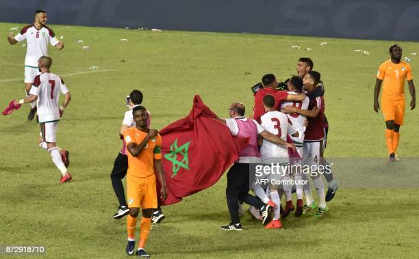 Morocco's players celebrate at the Felix HouphouetBoigny stadium in Abidjan on November 11 after the FIFA World Cup 2018 Africa Group C qualifying...