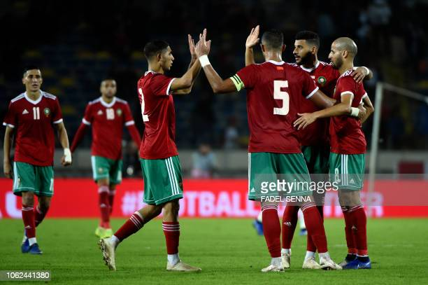Morocco's players celebrate their victory after the Africa Cup of Nations qualifier football match between Morocco and Cameroon at the Mohamed V...