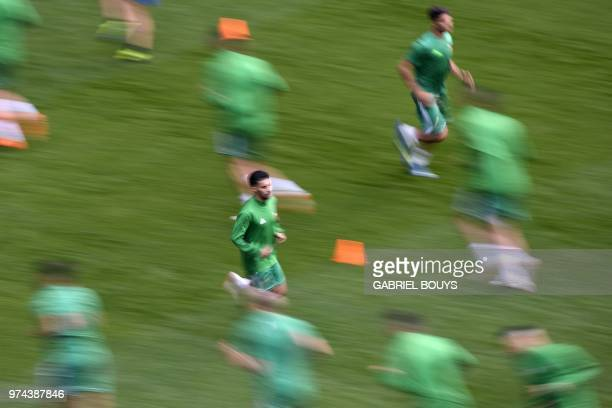 Morocco's players run during a training session at Saint Petersburg Stadium on June 14 ahead of the Russia 2018 World Cup football game Iran vs...