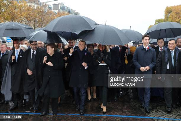 Morocco's Prince Moulay Hassan, Moroccan King Mohammed VI, German Chancellor Angela Merkel, French President Emmanuel Macron and his wife Brigitte...