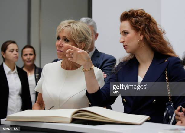 Morocco's Princess Lalla Salma speaks to French president's wife Brigitte Macron during their visit to the Picasso exhibition at the National Museum...