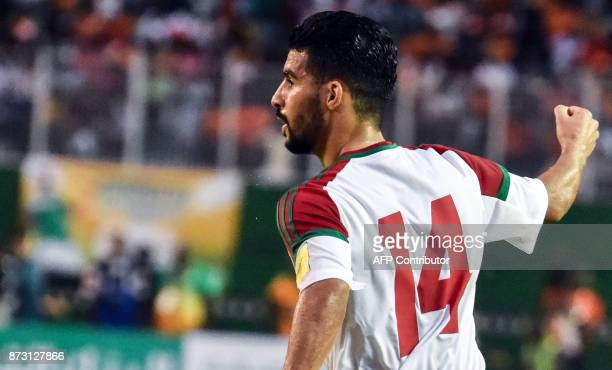 Morocco's team players Boussoufa Mbark celebrate a goal at the Felix HouphouetBoigny stadium in Abidjan on November 11 during the FIFA World Cup 2018...
