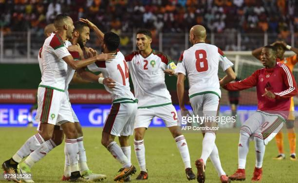Morocco's team players celebrate a goal at the Felix HouphouetBoigny stadium in Abidjan on November 11 during the FIFA World Cup 2018 Africa Group C...
