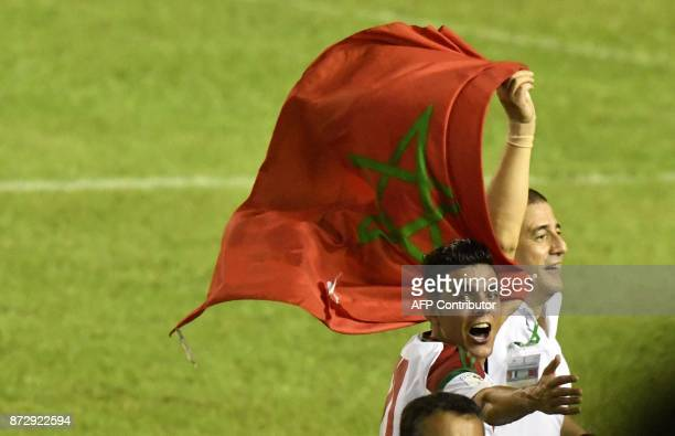 Morocco's team players celebrate at the Felix HouphouetBoigny stadium in Abidjan on November 11 at the end of the FIFA World Cup 2018 Africa Group C...