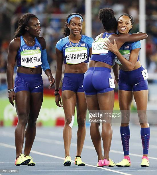 Morolake Akinosun English Gardner Tianna Bartoletta and Allyson Felix of the United States celebrate after qualifying for the women's 4x100meter...